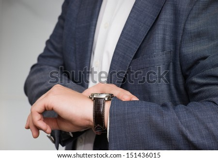 Businessman checking the time - stock photo