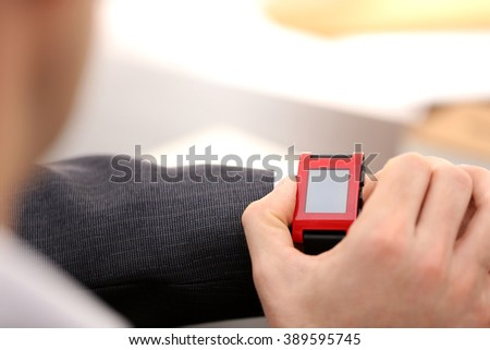 Businessman checking the time on his wrist watch, close up - stock photo