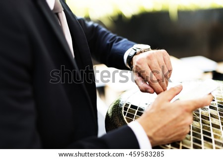 Businessman Checking Time Watch Concept