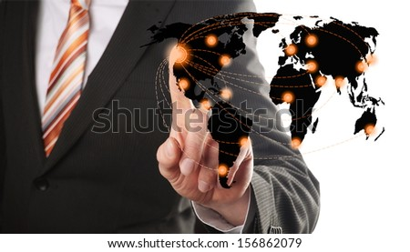 businessman choose one of his global network of a worldmap