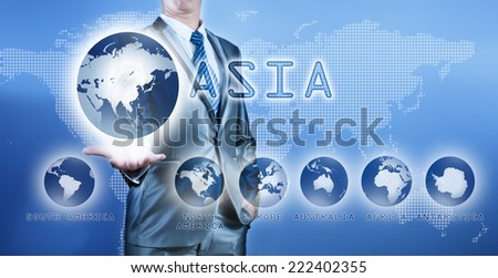Businessman choosing asia continent on virtual digital screen, business concept of decision making - stock photo