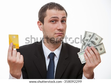 Businessman choosing plastic card or money, white background - stock photo