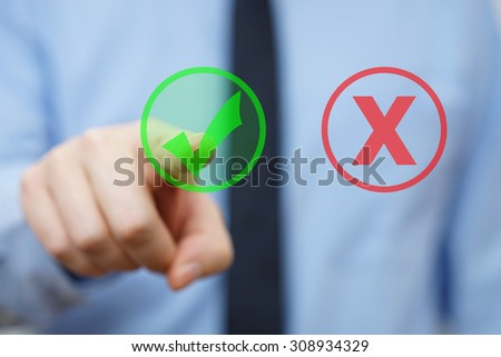 businessman choosing right answer icon instead wrong - stock photo