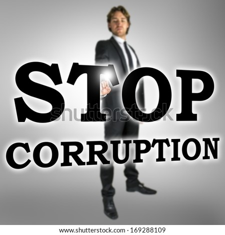 Businessman choosing Stop corruption icon on virtual interface. - stock photo