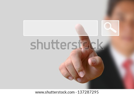 Businessman clicking internet search page on computer touch screen - stock photo