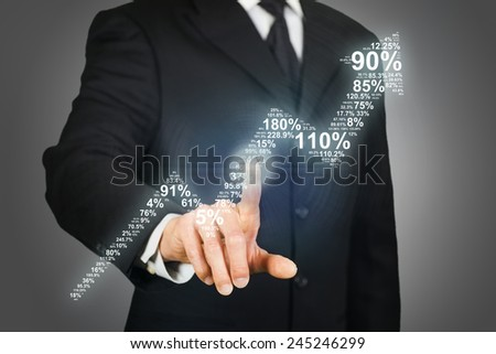 Businessman clicking on an upward arrow formed by numbers