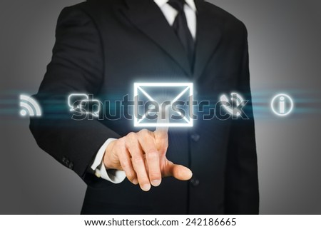 Businessman clicking on email icon - stock photo