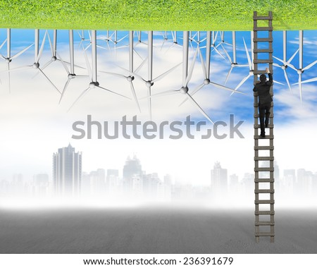 businessman climb on ladder between two inverted world with pollution cityscape and clean natural sky grass wind turbines, environmental protection and alternative energy concept - stock photo