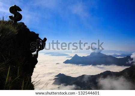 Businessman climbing a mountain, Business success concept - stock photo
