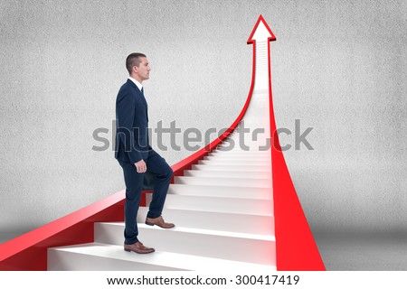 Businessman climbing against grey room - stock photo