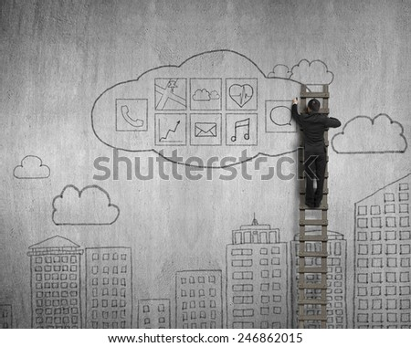 Businessman climbing and drawing cloud app icons doodles on concrete wall background - stock photo