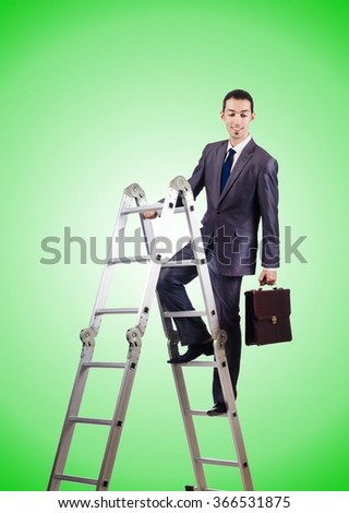 Businessman climbing career ladder against gradient  - stock photo