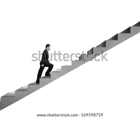 Businessman climbing on concrete stair isolated in white background