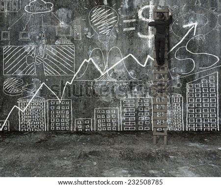 businessman climbing on ladder and drawing business concept doodles on old mottled concrete wall and floor background - stock photo