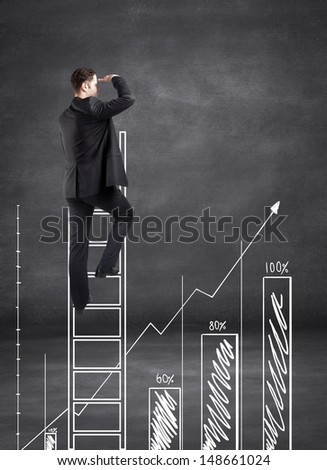 businessman climbing on ladder and looking on busines chart