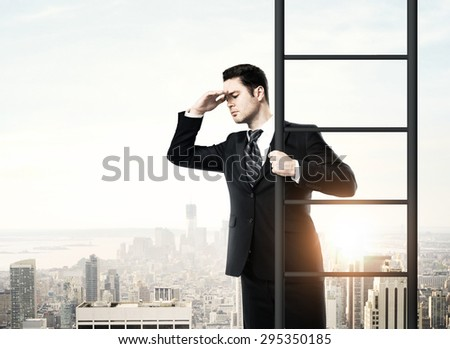 businessman climbing on ladder, urban business concept - stock photo
