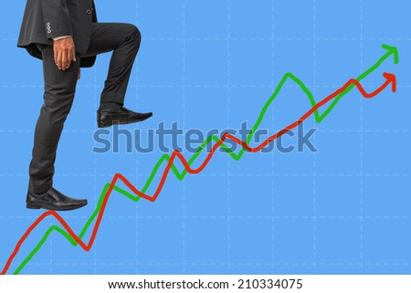 businessman climbing on line graph to success    - stock photo