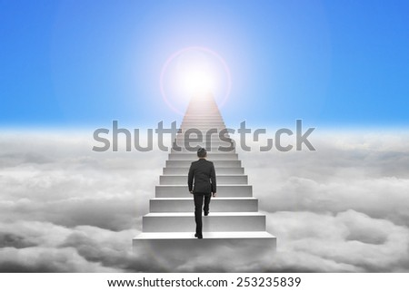 Businessman climbing the concrete stairs with blue sky sunlight cloudscape background - stock photo