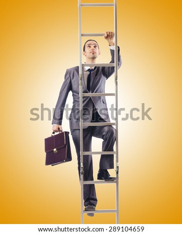 Businessman climbing the ladder against the gradient  - stock photo