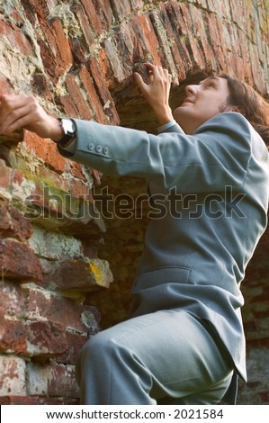 businessman climbing the wall - stock photo