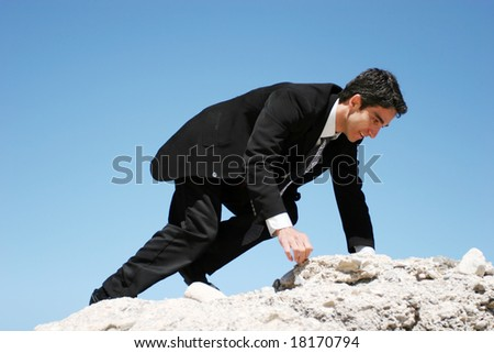 Businessman climbing to peak for success - stock photo