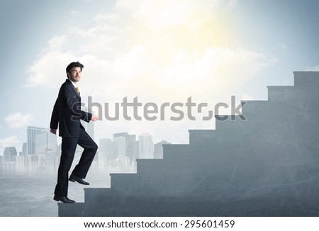 Businessman climbing up a concrete staircase concept on city background