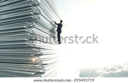 businessman climbing up a huge stack of paper - stock photo