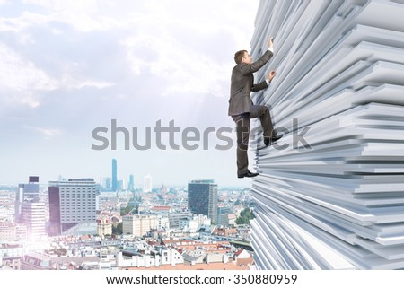 Businessman climbing up a huge stack of paper with city background - stock photo