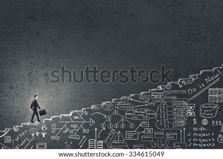 Businessman climbing up hand drawn staircase as symbol of career rise - stock photo