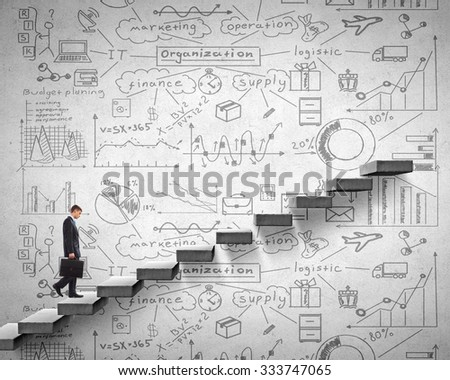 Businessman climbing up staircase as symbol of career rise - stock photo