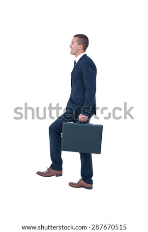 Businessman climbing with briefcase on white background