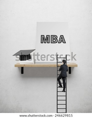 Businessman climbs the stairs on shelf, mba concept - stock photo