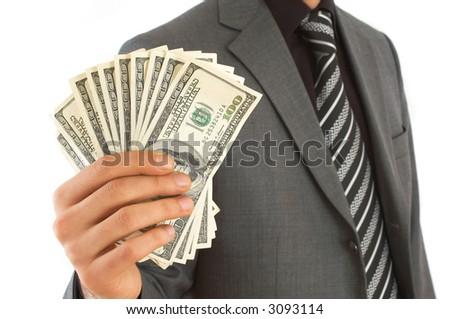 businessman close up with US dollars, shallow dof - stock photo