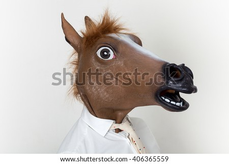 Businessman closeup portrait wearing horse head - stock photo