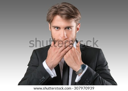 Businessman closing mouth with hands. Shut up - stock photo