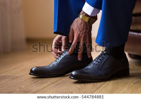 businessman clothes shoes, Politician, man's style, Businessman buttoning his shirt,male hands closeup, American, European businessman, People, business, fashion and clothing concept