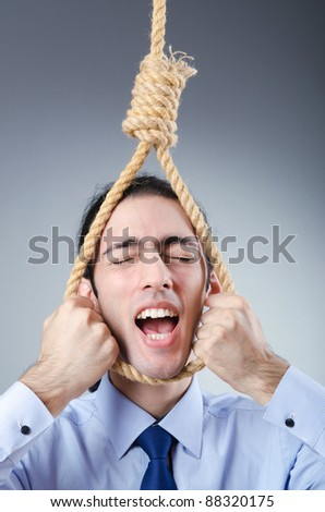 Businessman committing suicide through hanging - stock photo