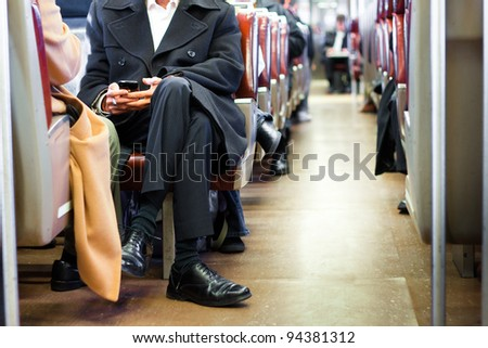 Businessman commuting on a train - stock photo