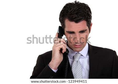 Businessman  concentrating during call - stock photo