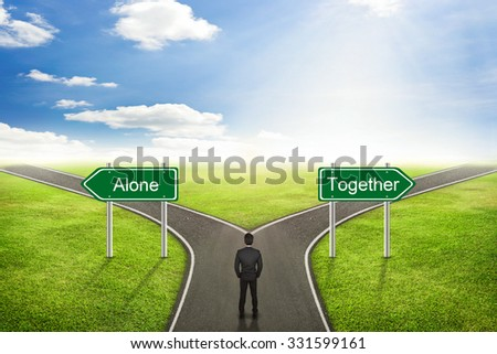 Businessman concept, Alone or Together road the correct way. - stock photo