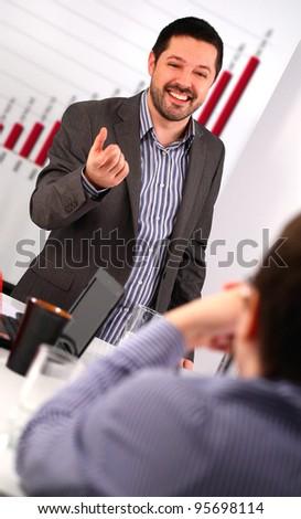 Businessman conducting a business training - stock photo