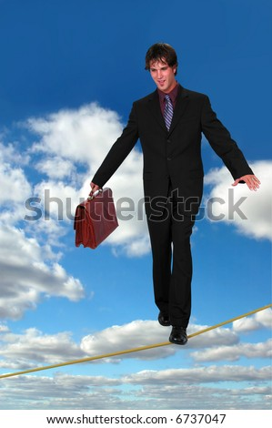 Businessman confidently walking on tightrope holding a briefcase over a sky background.