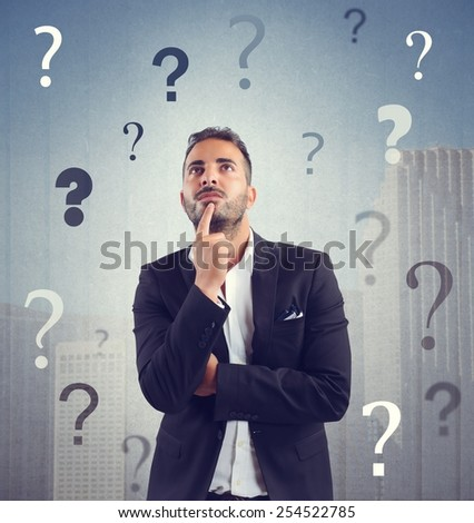 Businessman confused and concerned about the company - stock photo