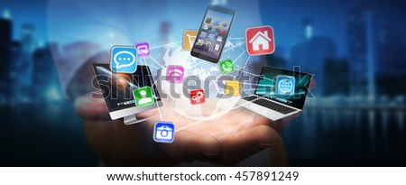 Businessman connected tech devices and icons applications to a digital planet earth '3D rendering'