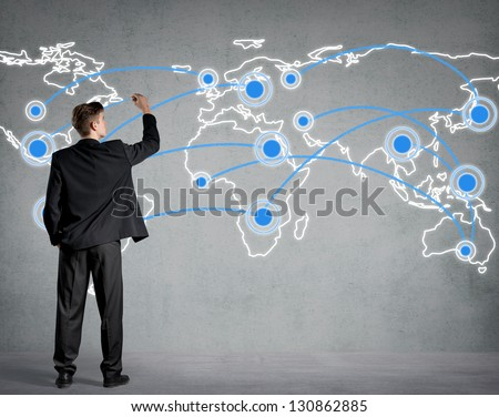 Businessman connecting the dots on a world map - stock photo