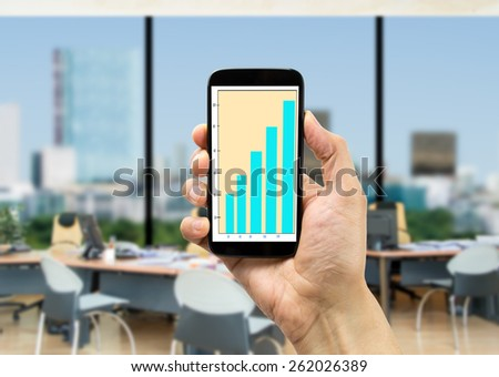 Businessman consulting a chart on your cellphone - stock photo