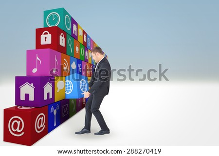 Businessman contorted with hands down against blue sky - stock photo