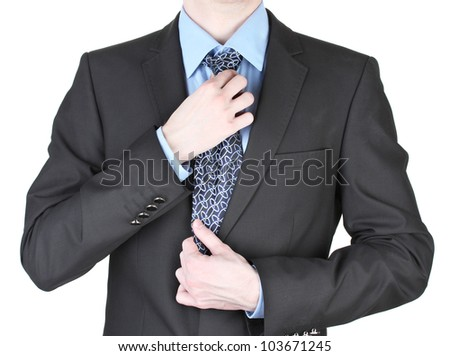 businessman correcting a tie close up - stock photo