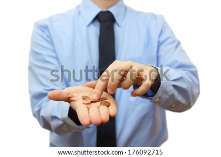 businessman counting coins on hand. Crisis concept - stock photo