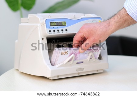 Businessman counting 500 Euro banknotes. An electronic money counter processing Euro 500 bills. European Union Currency. Counting Money. Business.  - stock photo
